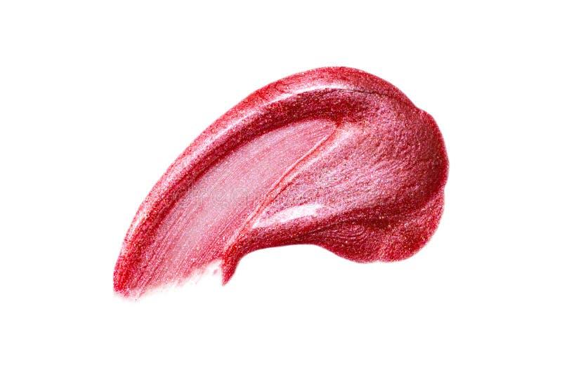 在白色隔绝的唇彩样品 被弄脏的红色lipgloss 图库摄影