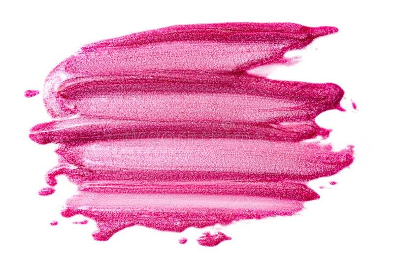 在白色隔绝的唇彩 被弄脏的桃红色构成产品样品 免版税库存照片
