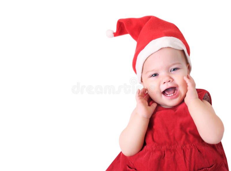 在白色隔绝的圣诞老人帽子的婴孩 免版税库存图片