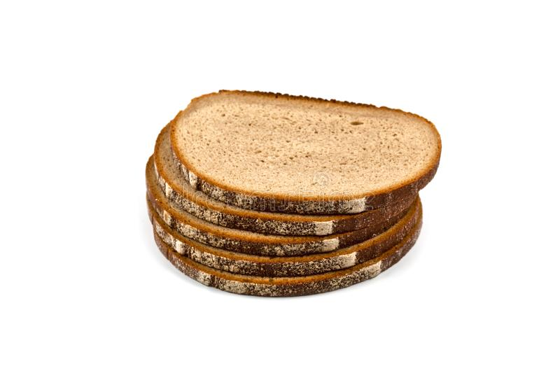 在白色隔绝的堆五个新被烘烤的面包切片 免版税图库摄影