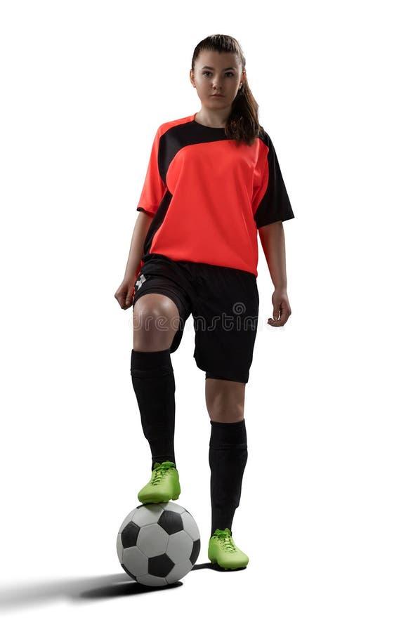 在白色隔绝的女性足球运动员 库存照片