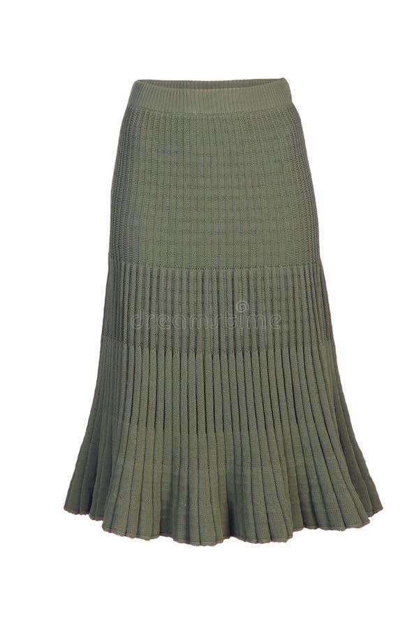 在白色隔绝的妇女的绿色编织裙子 库存照片