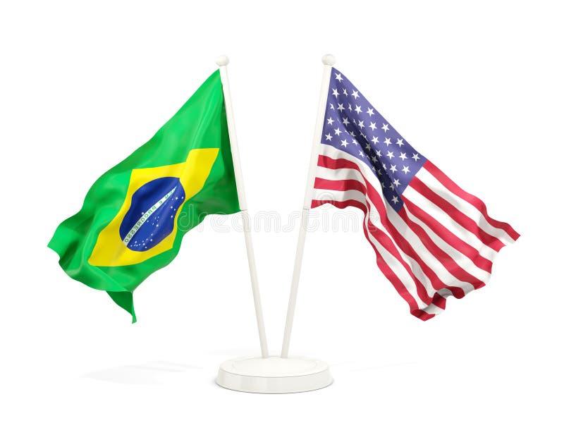 在白色隔绝的巴西和美国的两面挥动的旗子 皇族释放例证