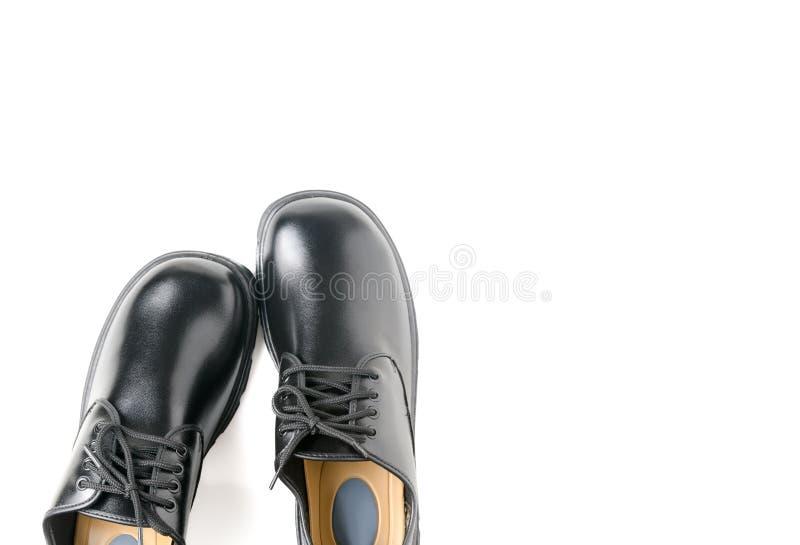 在白色隔绝的新的皮革学生鞋子 库存图片