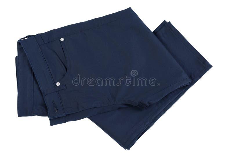 在白色隔绝的新的黑长的裤子 免版税库存图片