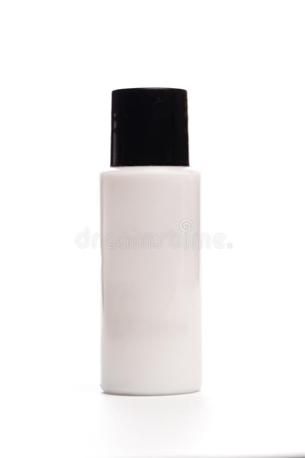 在白色隔绝的旅馆化妆瓶 库存图片