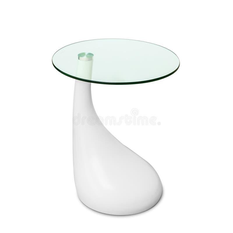 在白色隔绝的现代玻璃桌 免版税库存照片