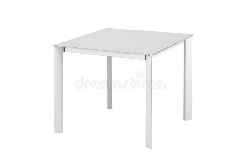在白色隔绝的白色桌 库存照片
