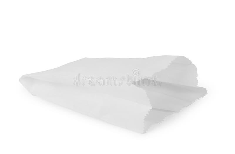在白色隔绝的空白的快餐纸袋包裹正面图与裁减路线 免版税库存照片