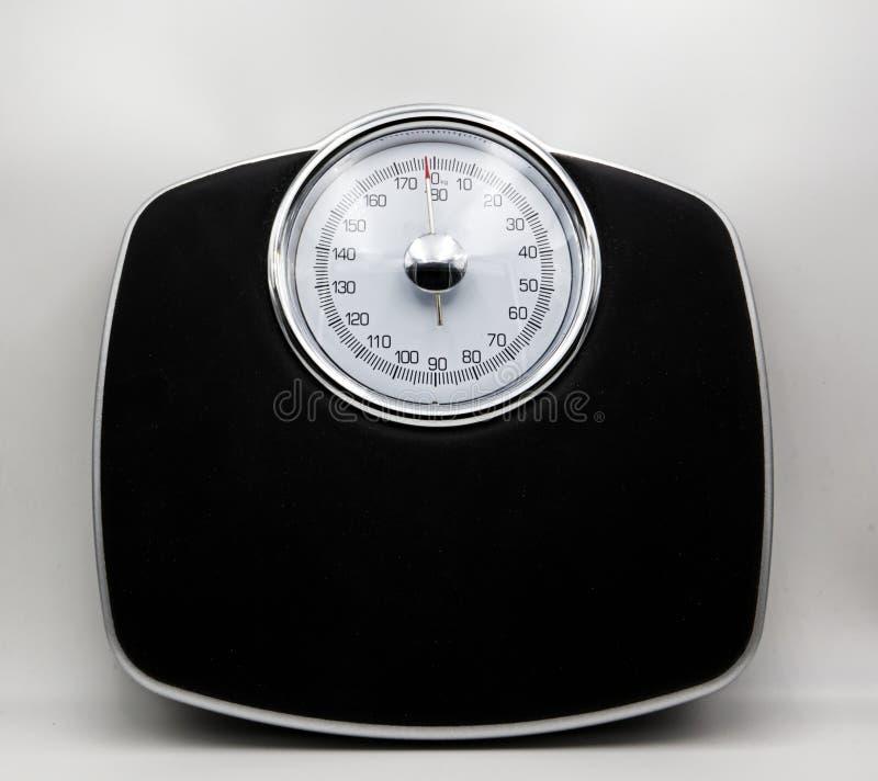 在白色隔绝的类推标度 重量控制概念 库存照片