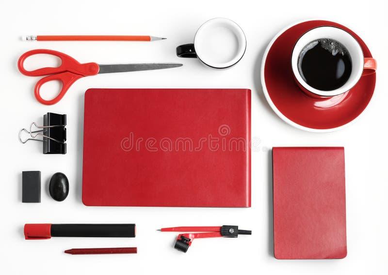 在白色隔绝的红色文具 免版税图库摄影