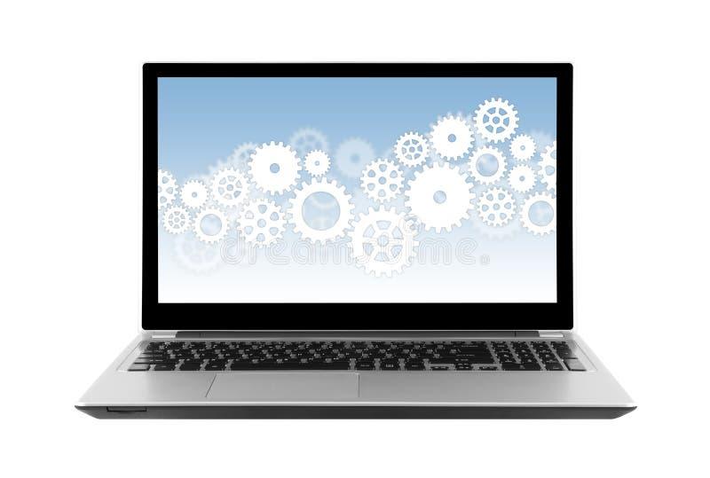 在白色隔绝的膝上型计算机屏幕上的齿轮 免版税库存照片