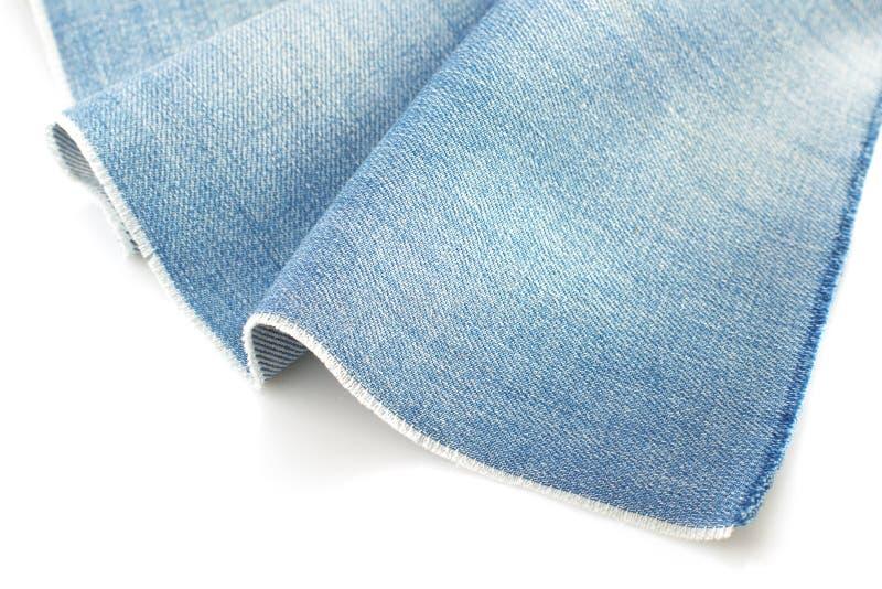 在白色隔绝的蓝色牛仔裤牛仔布 免版税库存图片