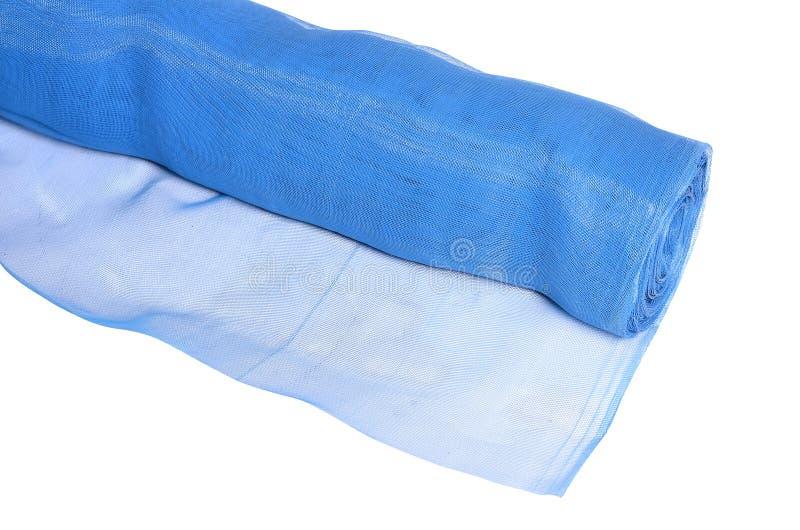 在白色隔绝的蓝色蚊帐卷  免版税图库摄影