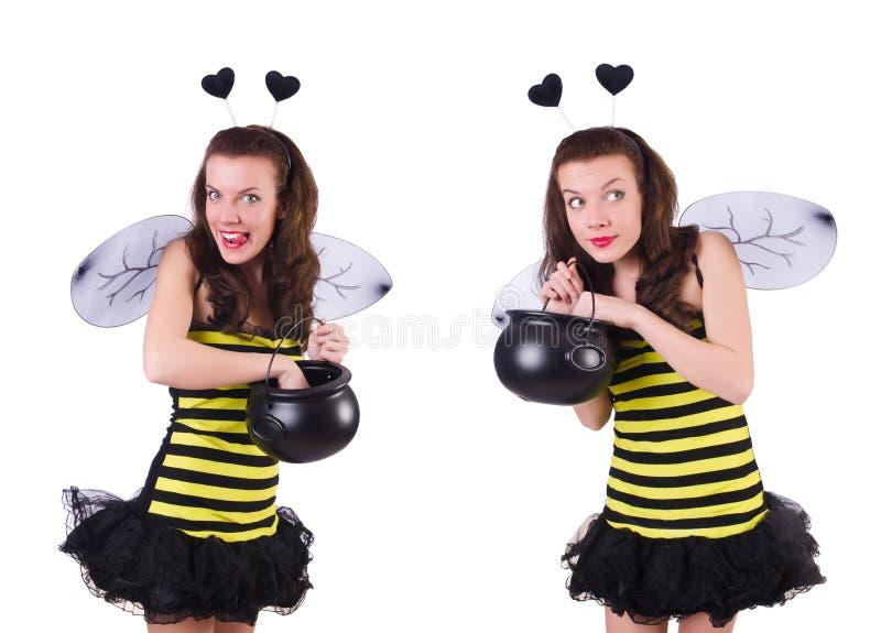 在白色隔绝的蜂服装的年轻女人 免版税库存照片
