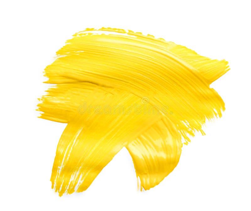 在白色隔绝的黄色油漆抽象绘画的技巧 免版税库存照片