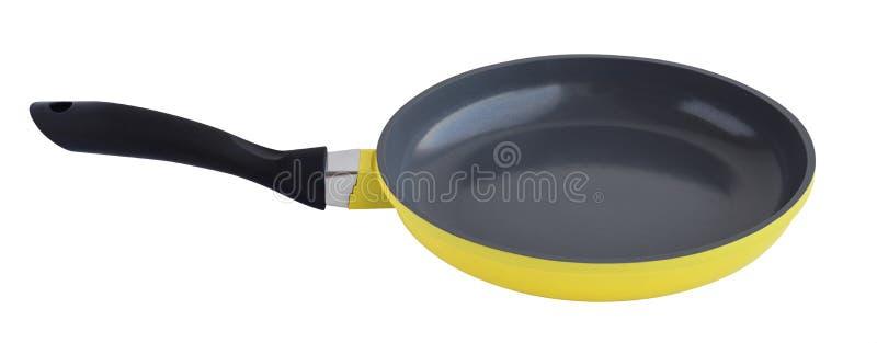 在白色隔绝的黄色煎锅 免版税图库摄影