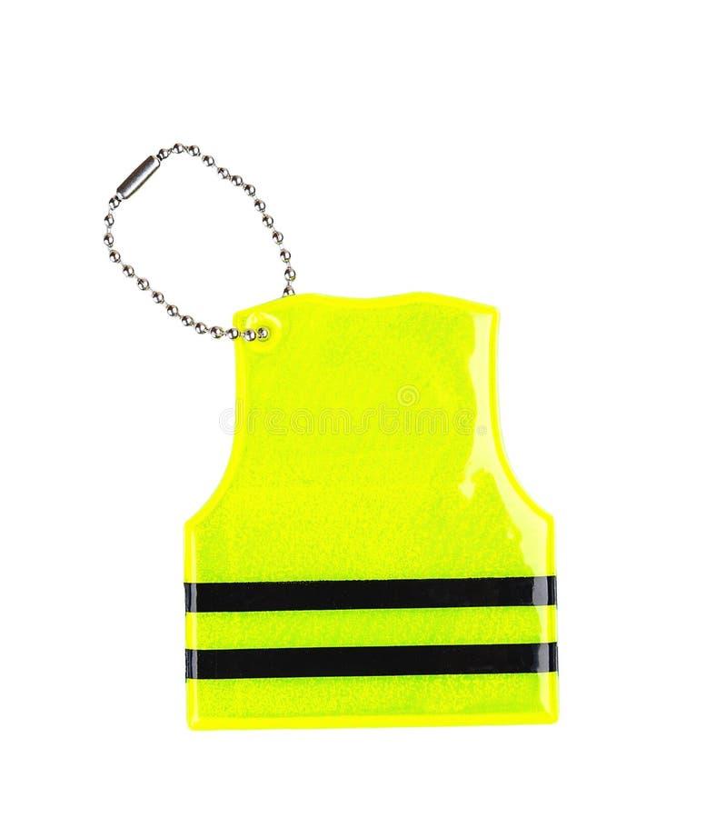在白色隔绝的黄色pedestrain安全反射器keychain 免版税库存照片