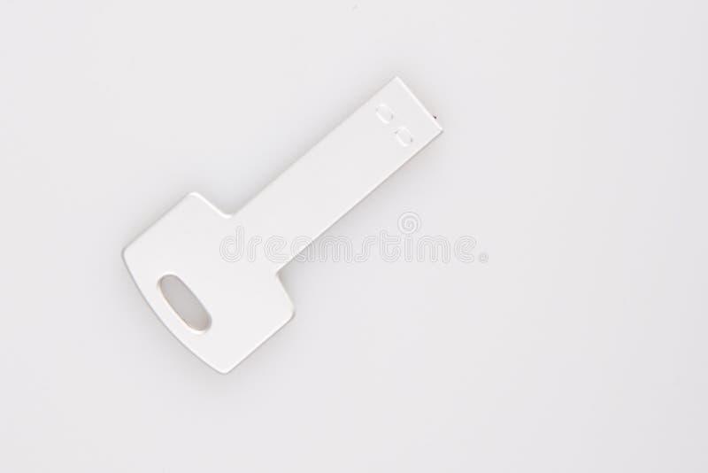 在白色隔绝的USB关键一刹那推进棍子记忆 免版税库存照片