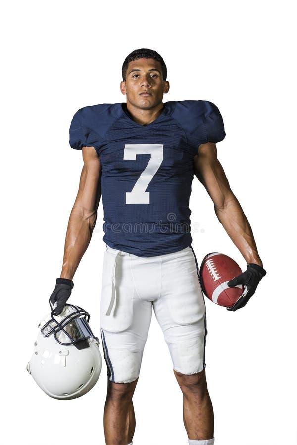 在白色隔绝的一名坚强的肌肉美国橄榄球运动员的画象 免版税库存图片