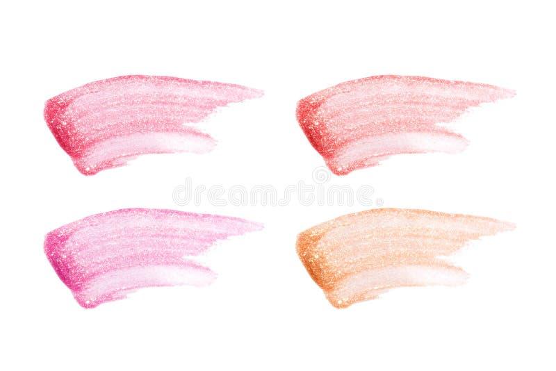 在白色隔绝的不同的嘴唇光泽 被弄脏的嘴唇光泽样品 图库摄影