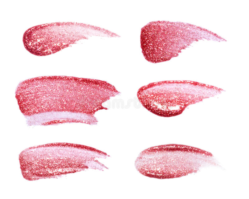 在白色隔绝的不同的嘴唇光泽 被弄脏的嘴唇光泽样品 免版税库存图片