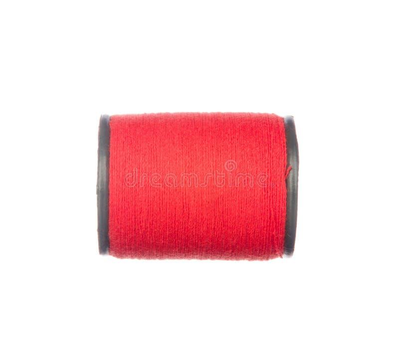在白色隔绝的五颜六色的红色螺纹 库存照片