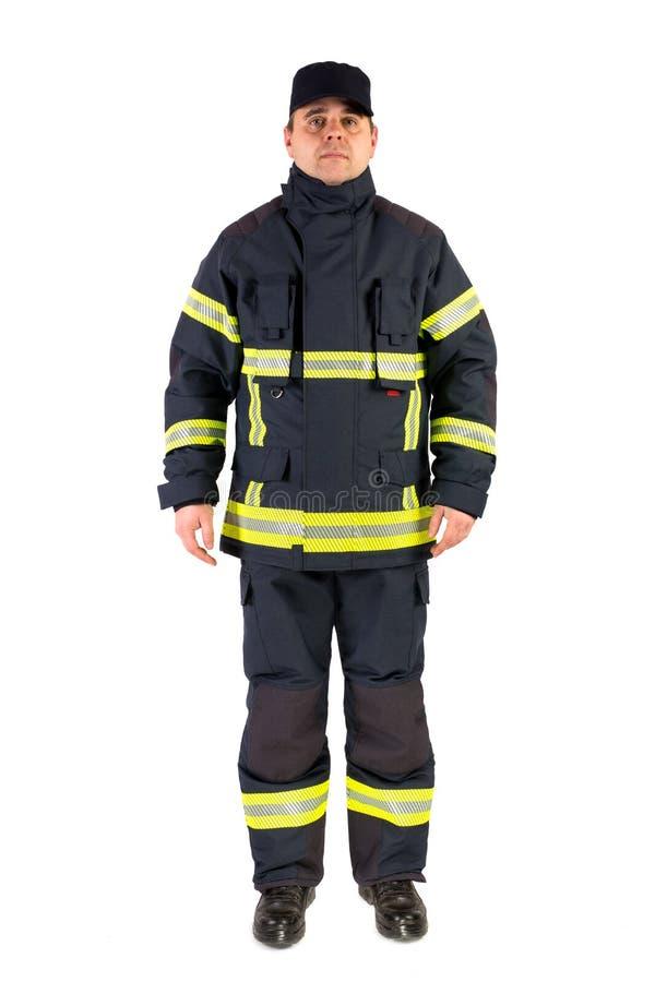在白色隔绝的制服的消防员 免版税库存图片