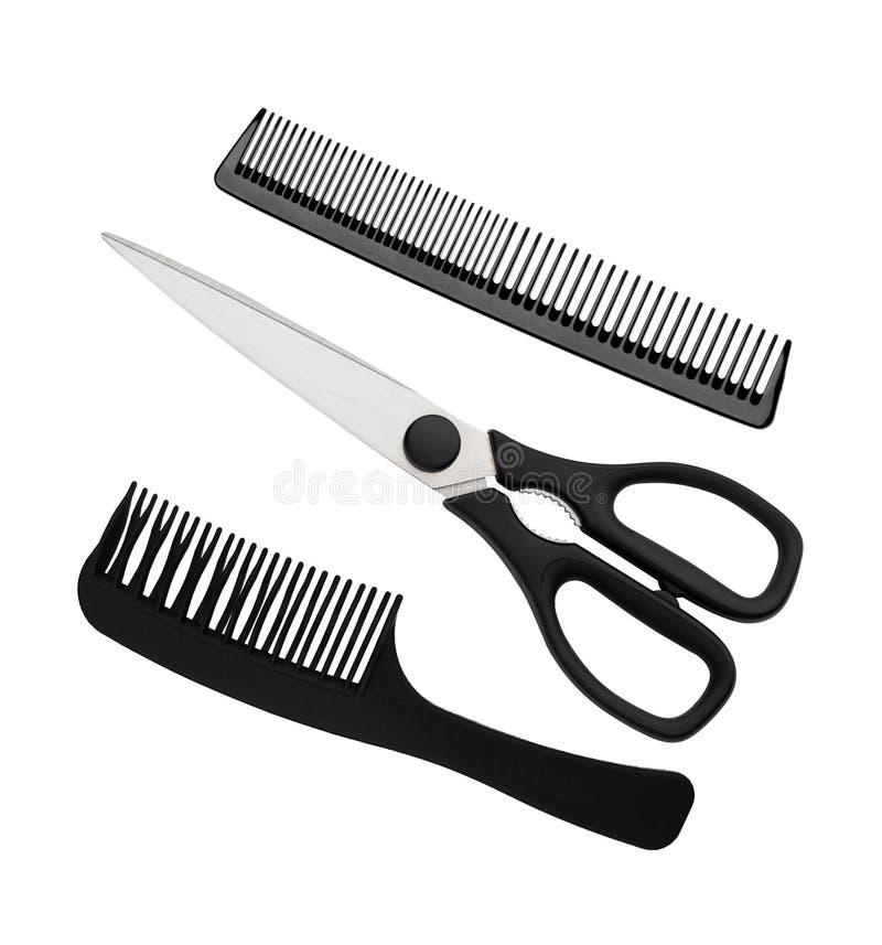 黑在白色隔绝的剪刀和梳子 免版税库存照片