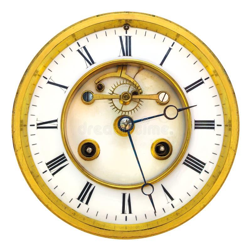 在白色隔绝的古老金黄开放时钟表盘 库存图片