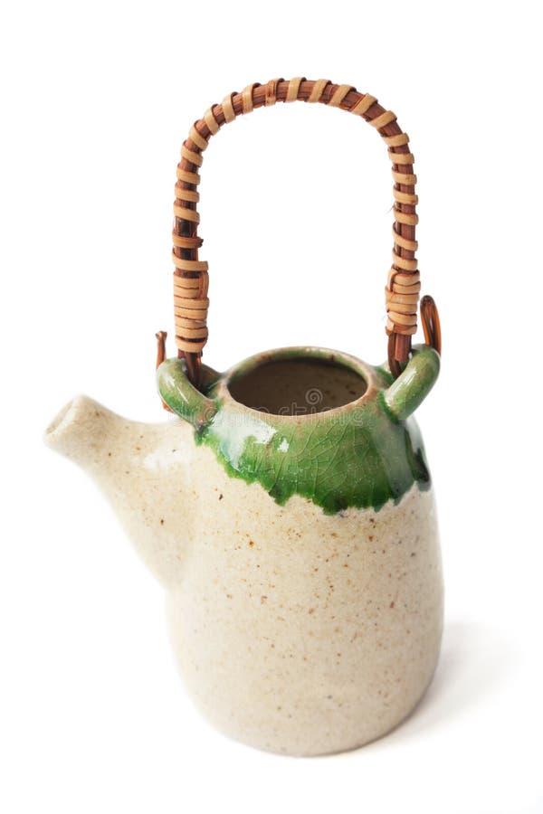 在白色隔绝的可爱的矮小的亚洲陶瓷给上釉的茶壶 免版税库存图片