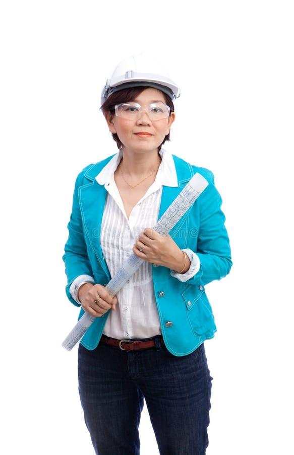 在白色隔绝的女性建筑师 免版税库存图片