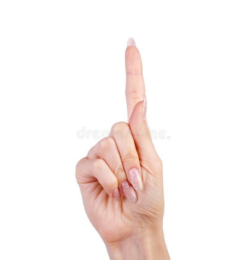 在白色隔绝的妇女手上的食指 图库摄影