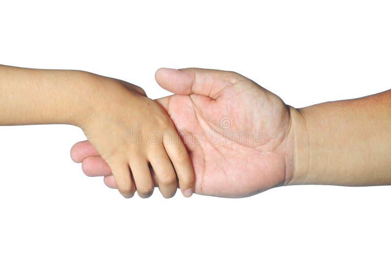 在白色隔绝的孩子手举行成人手指 库存图片