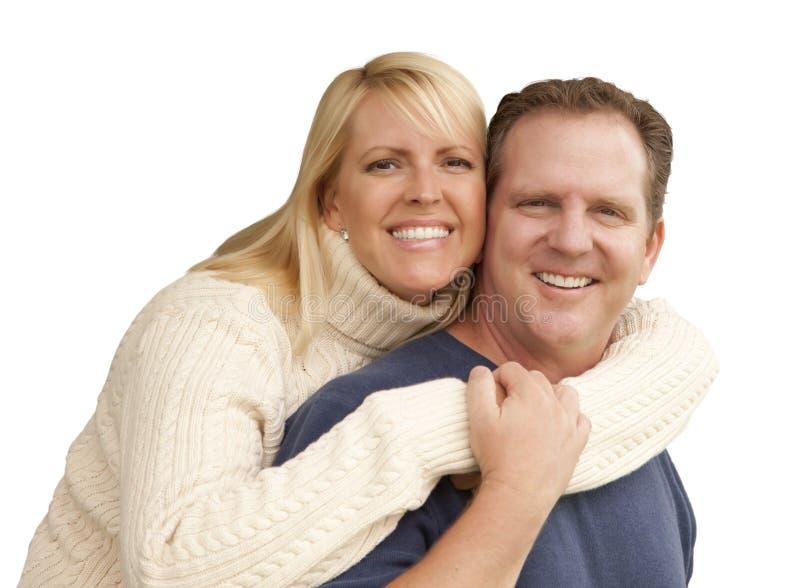 在白色隔绝的愉快有吸引力夫妇拥抱 免版税库存图片
