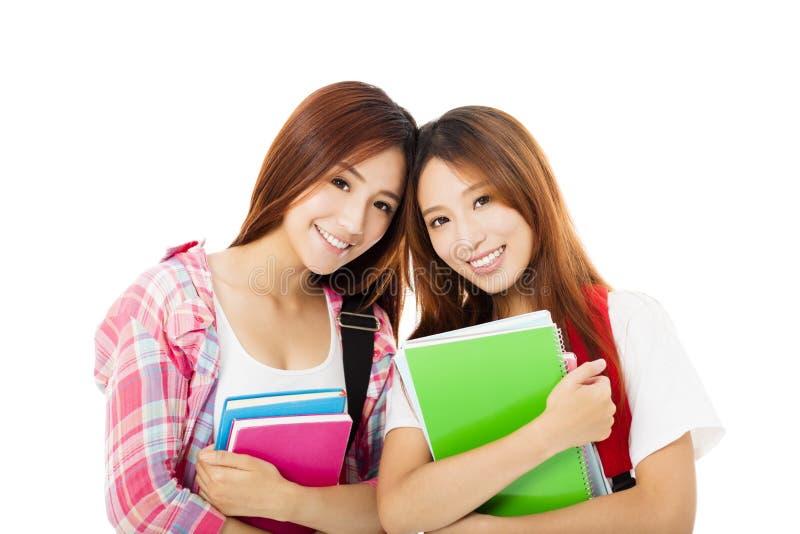 在白色隔绝的愉快的少年学生女孩 免版税图库摄影