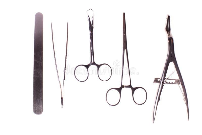 在白色隔绝的手术仪器 库存图片