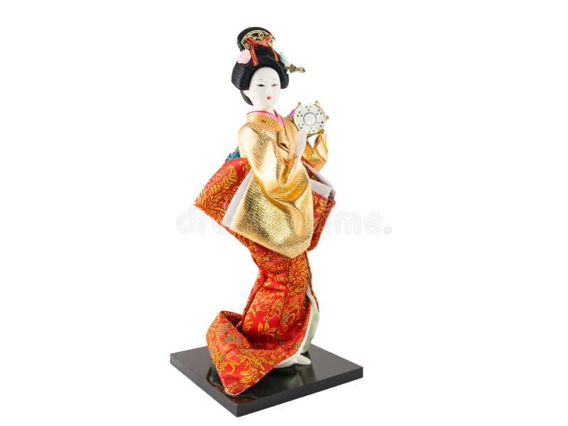 在白色隔绝的日本艺妓玩偶。 库存图片