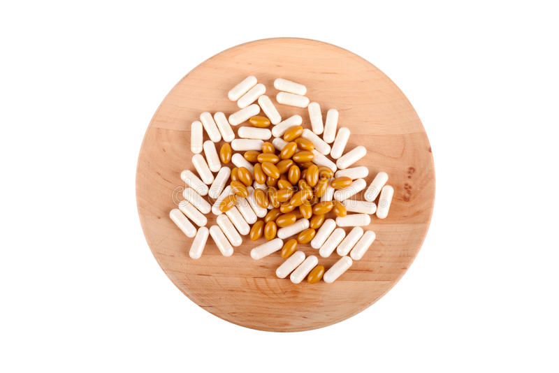 在白色隔绝的木板材的药片 免版税库存图片