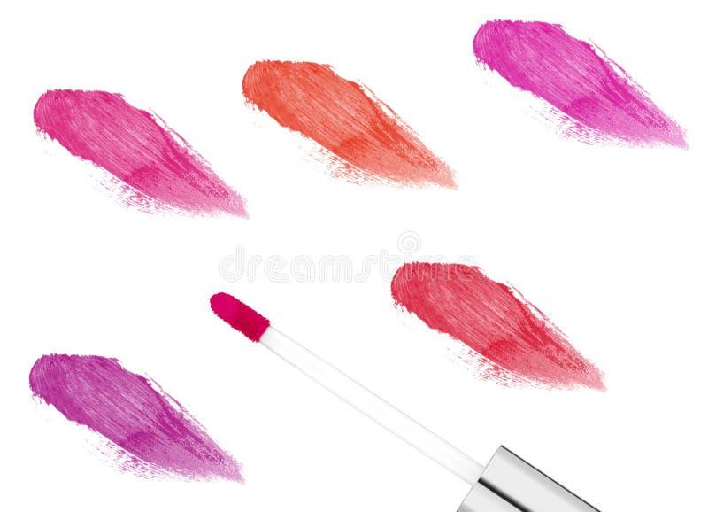 在白色隔绝的桃红色lipgloss 库存照片