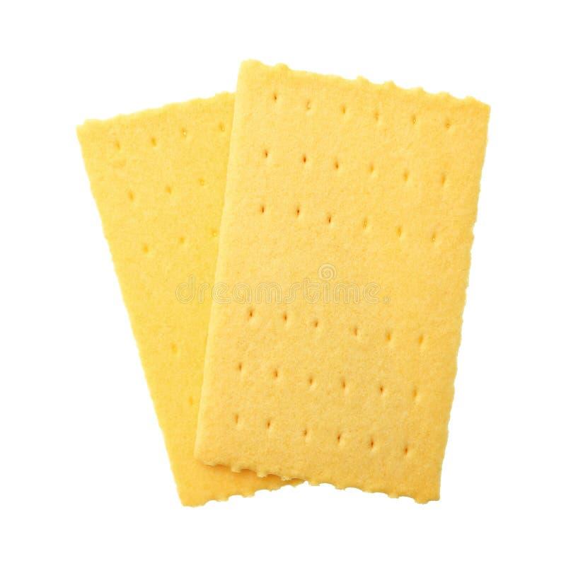 在白色隔绝的涂奶油的面包 免版税库存照片