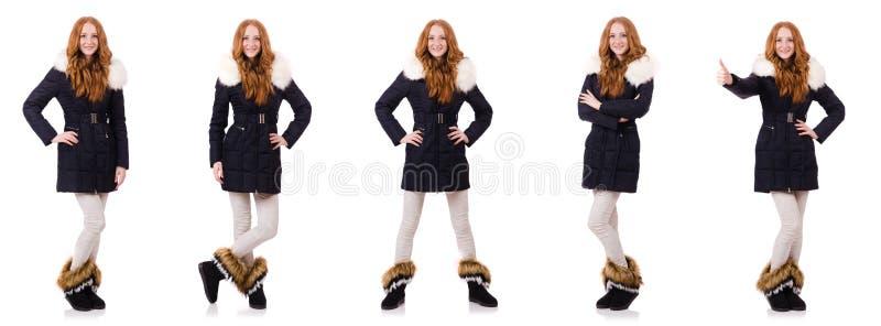 在白色隔绝的温暖的衣裳的俏丽的女孩 库存照片