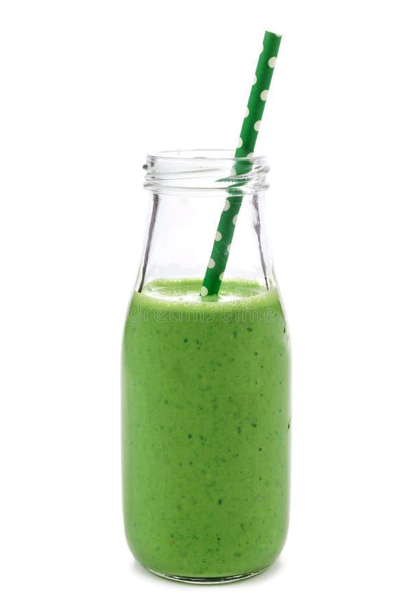 在白色隔绝的牛奶瓶的绿色圆滑的人 库存图片