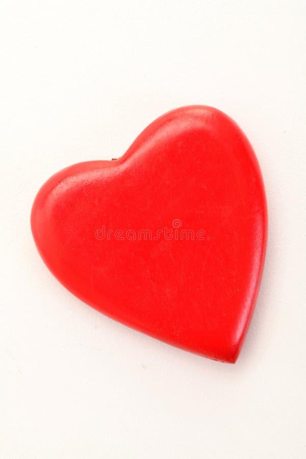 在白色隔绝的红色心脏 免版税库存图片