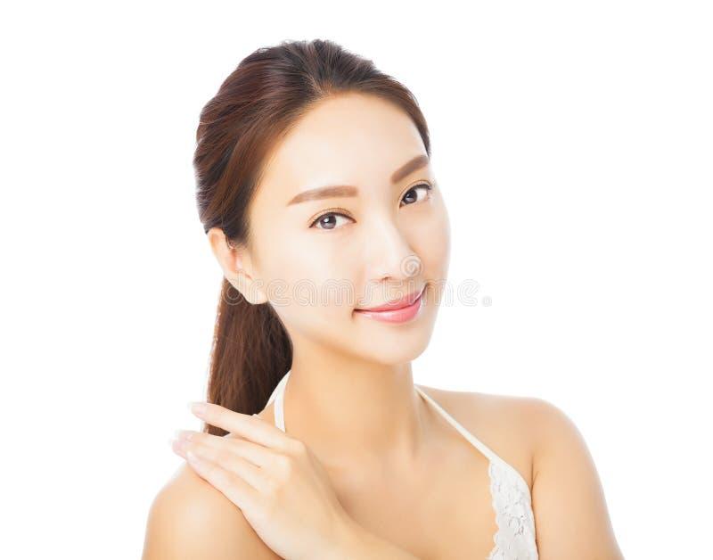 在白色隔绝的美丽的年轻亚洲妇女面孔 图库摄影