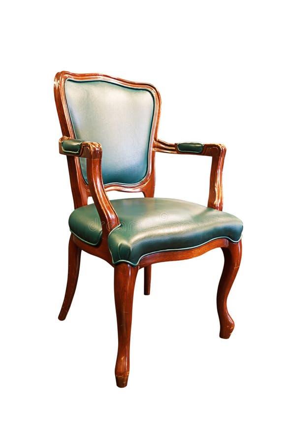 在白色隔绝的老绿色皮椅 库存照片