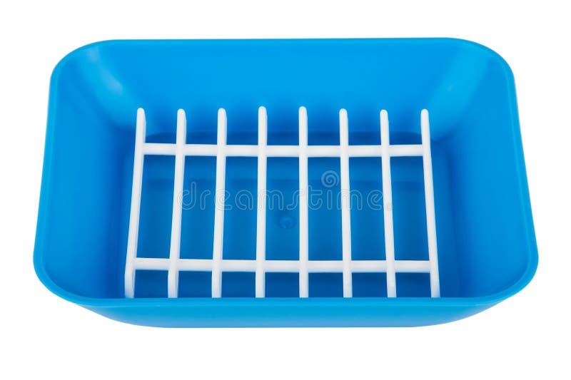 在白色隔绝的蓝色塑料浴皂盒 免版税图库摄影