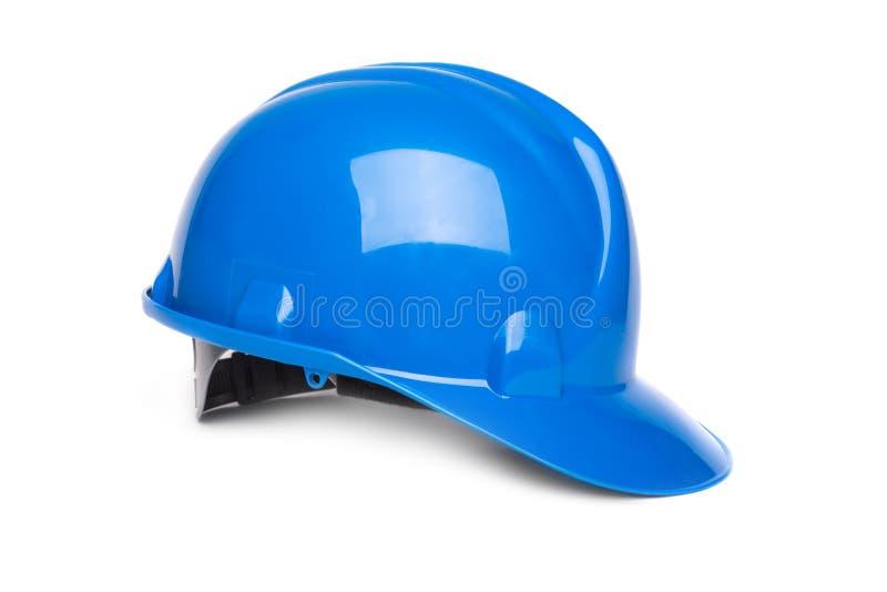 在白色隔绝的蓝色安全帽 库存照片