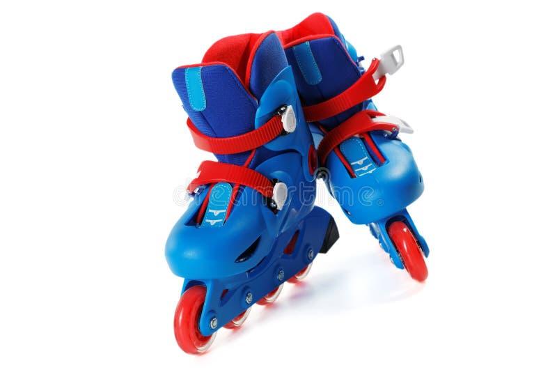 在白色隔绝的蓝色溜冰鞋 免版税库存照片