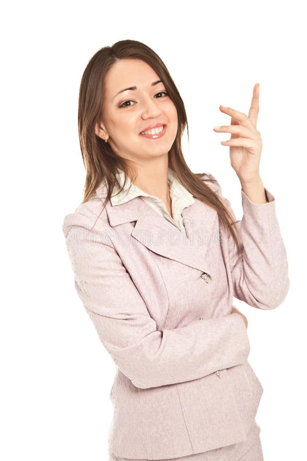 在白色隔绝的衣服的美丽的女实业家 免版税库存图片